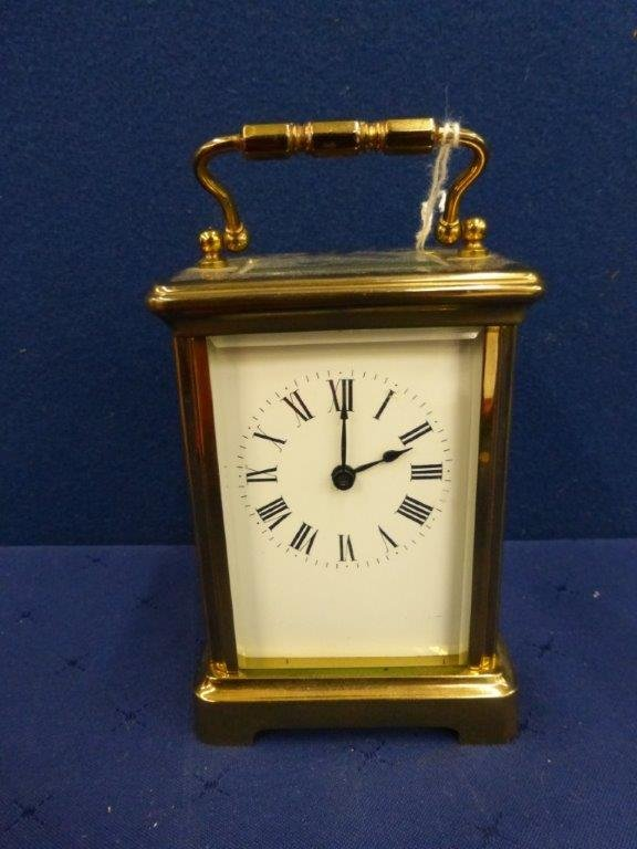 A brass bevel edged carriage clock, made by R and C of