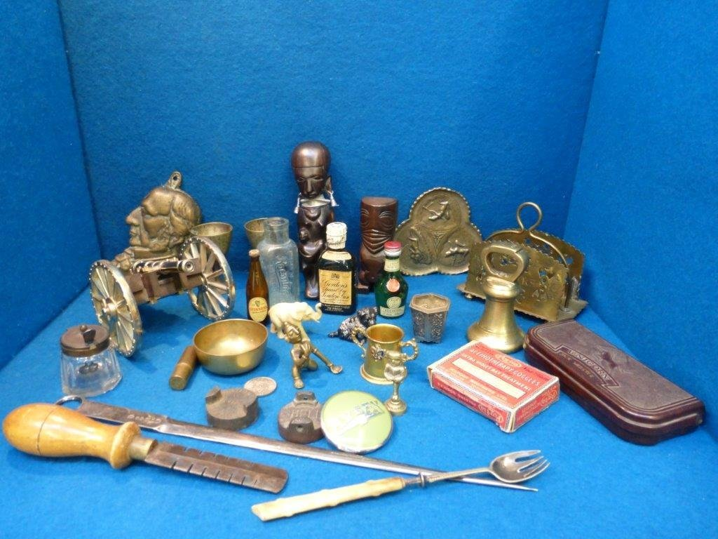 A box of mixed collectables including metalware,