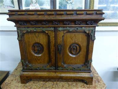 An early 19th century Gothic revival carved oak table