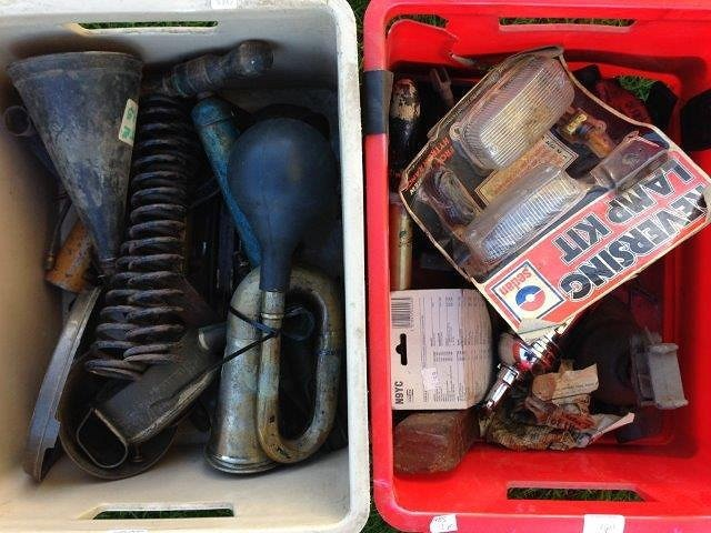 Two boxes of assorted parts and spares to include car