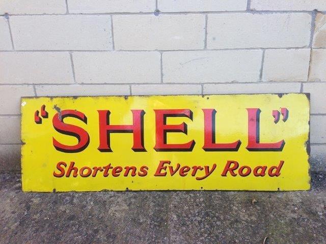 A Shell 'Shortens Every Road' rectangular enamel sign,