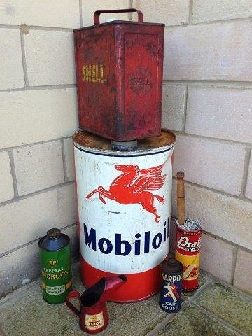 A Shell two gallon petrol can, a Mobiloil cylindrical