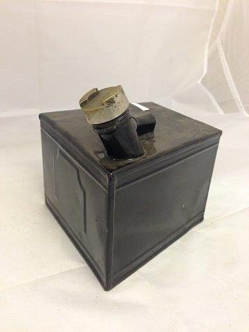 An Austin 7 petrol can of unusual shaped form to fit on