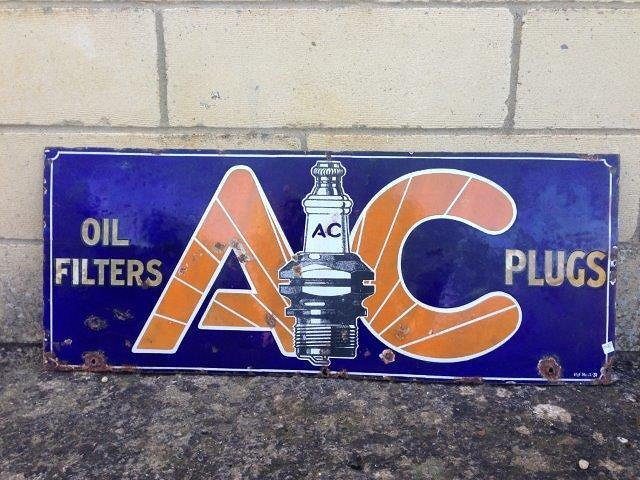 An AC Plugs and Oil Filters rectangular enamel sign, 30
