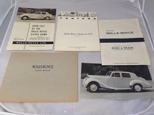 A Rolls-Royce Silver Wraith brochure and four others.