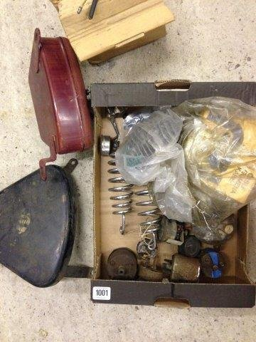 A box of assorted motorcycle parts to include