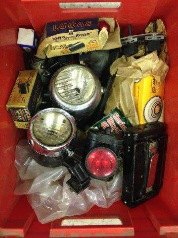 A box of cycle related parts to include Miller lamps