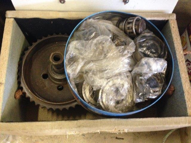 A quantity of motorcycle bearings and sprockets etc.