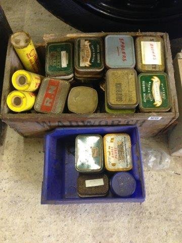 Two boxes of assorted small tins of spanners