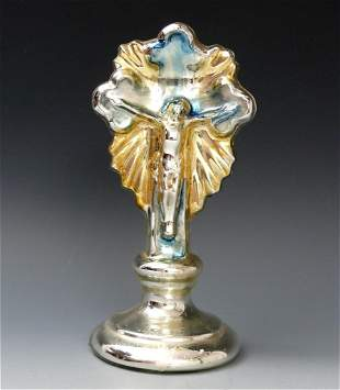 6: Bauer silver crucifix.