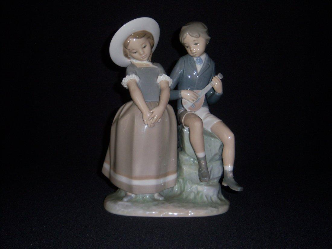 5: Lladro Girl with Boy playing Mandoline