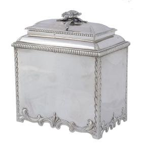 A George III silver pair of tea caddies and a sugar box