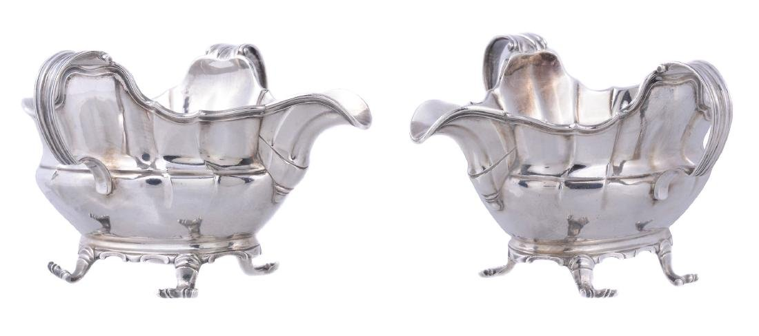 A pair of mid 18th century Belgian silver shaped oval