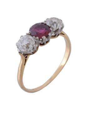 An Edwardian ruby and diamond three stone ring , circa