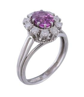 A pink sapphire and diamond cluster ring, the central
