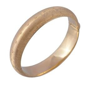 A gold bangle by Federico Buccellati, the hinged bangle