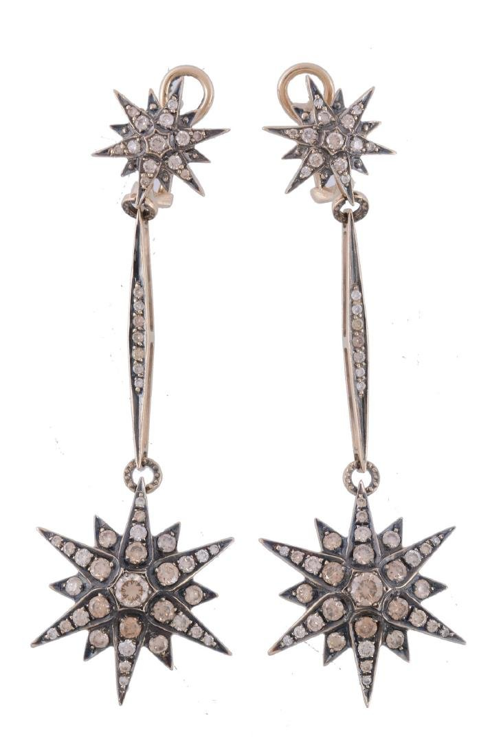 A pair of brown diamond Genesis earrings by H