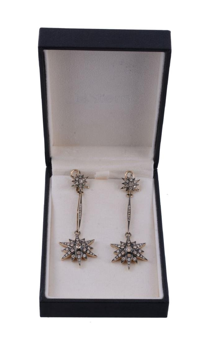 A pair of brown diamond Genesis earrings by H - 2