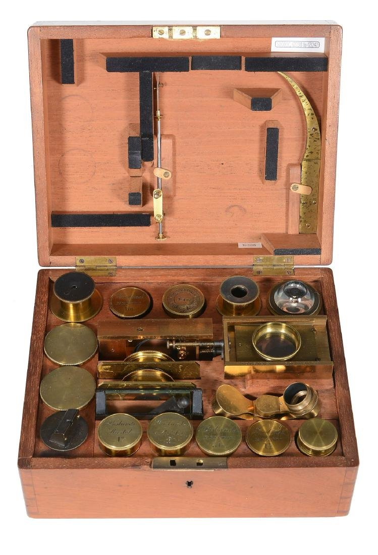 A cased selection of microscope accessories Husbands,