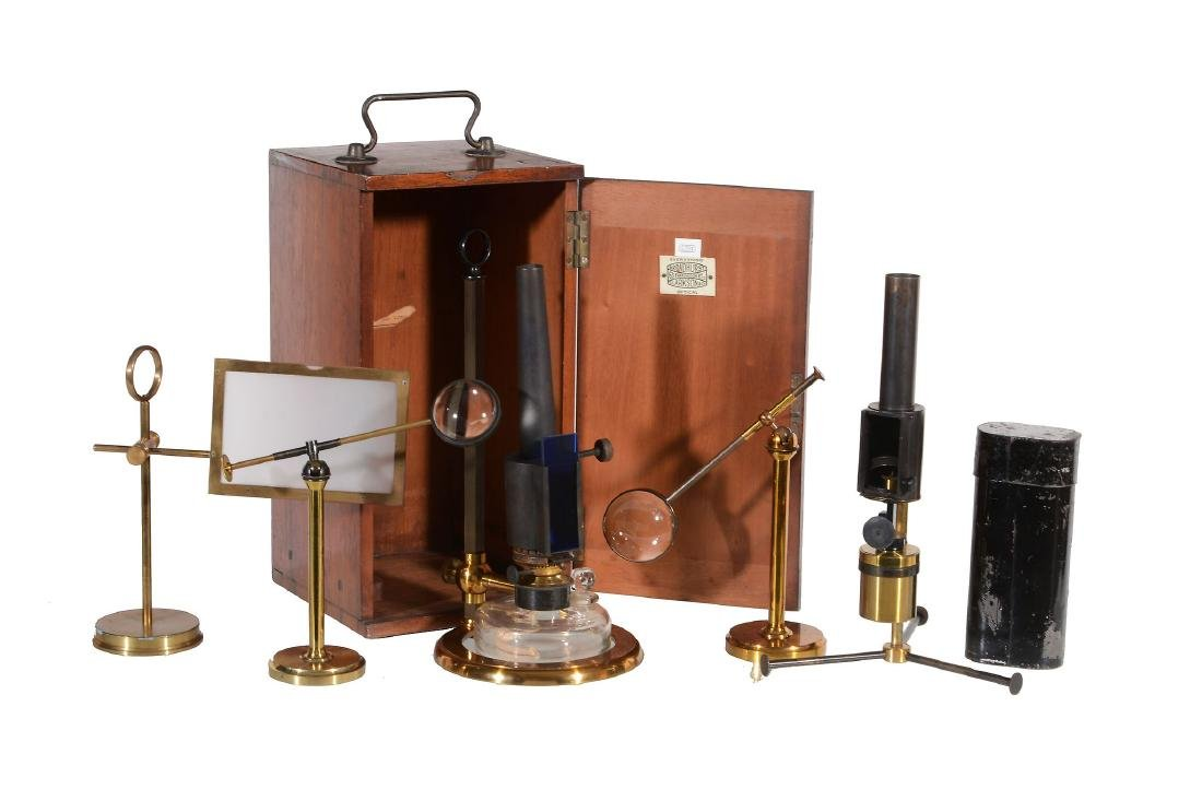 A Victorian lacquered and patinated brass microscope