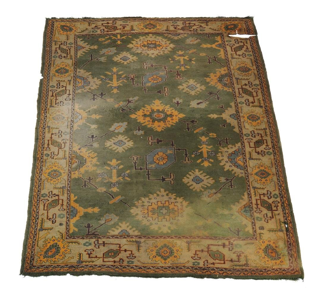 An Ushak carpet, the green field decorated with