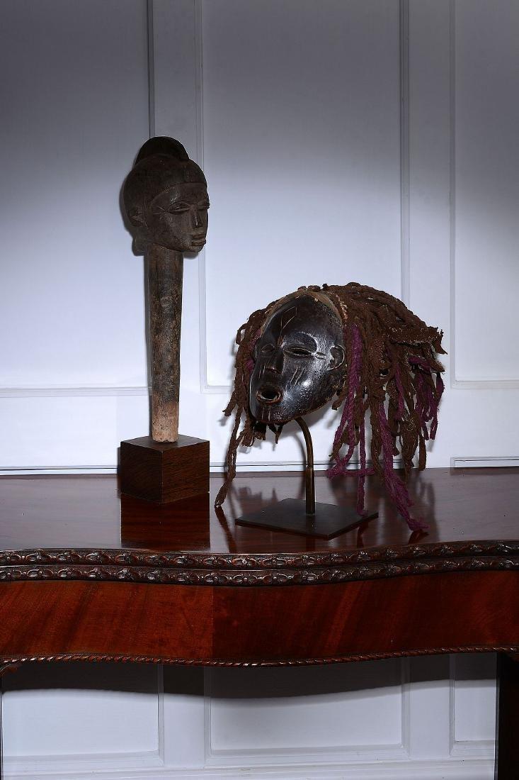 A fine Lobi head Burkina faso, circa 1910 the vertical