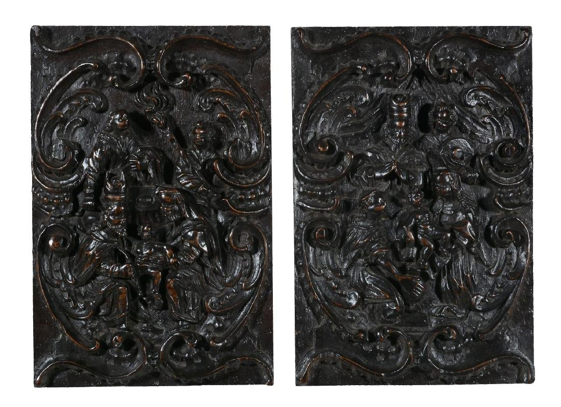 A pair of Tudor carved and stained oak figural relief