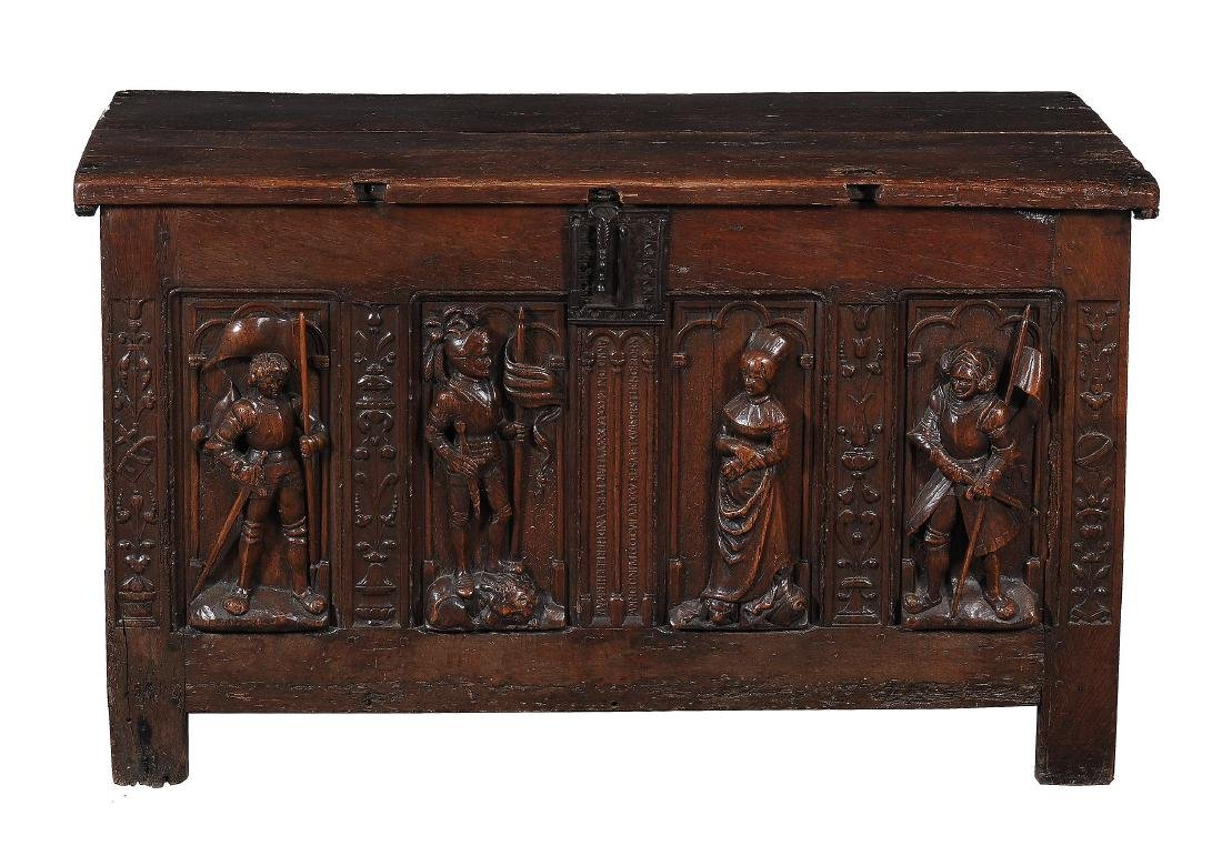 A German carved oak chest, circa 1535, the hinged plank