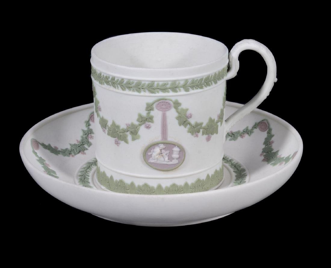 A Wedgwood three colour jasper coffee can and saucer,