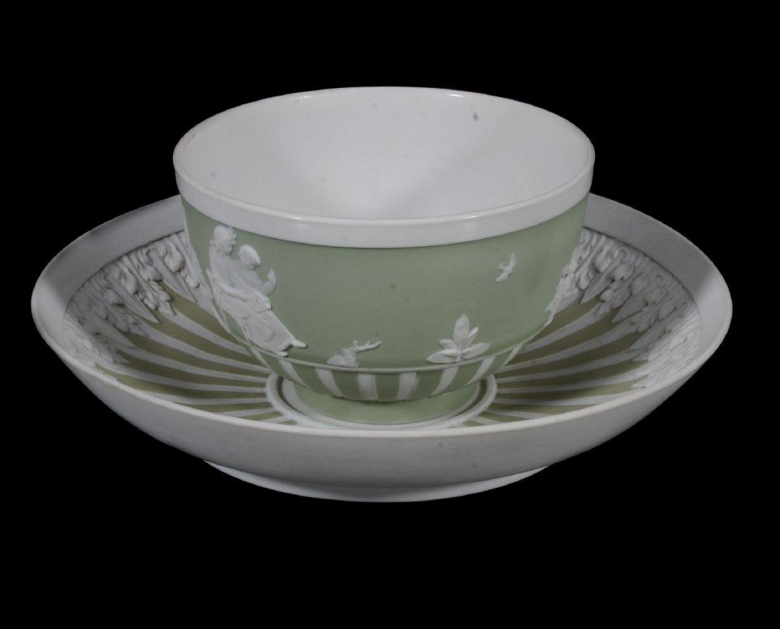 A Wedgwood pale-green jasper-dip tea bowl and saucer,