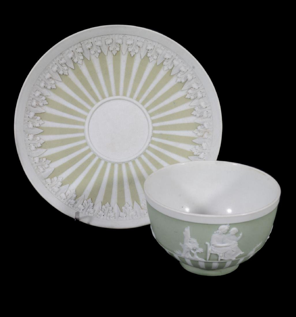 A Wedgwood pale-green jasper-dip tea bowl and saucer, - 2