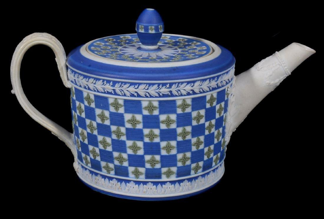 A Wedgwood tri-colour jasper 'diced' cylindrical teapot