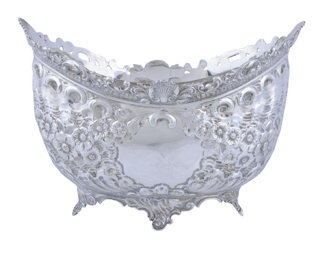 A late Victorian silver small flower basket by James