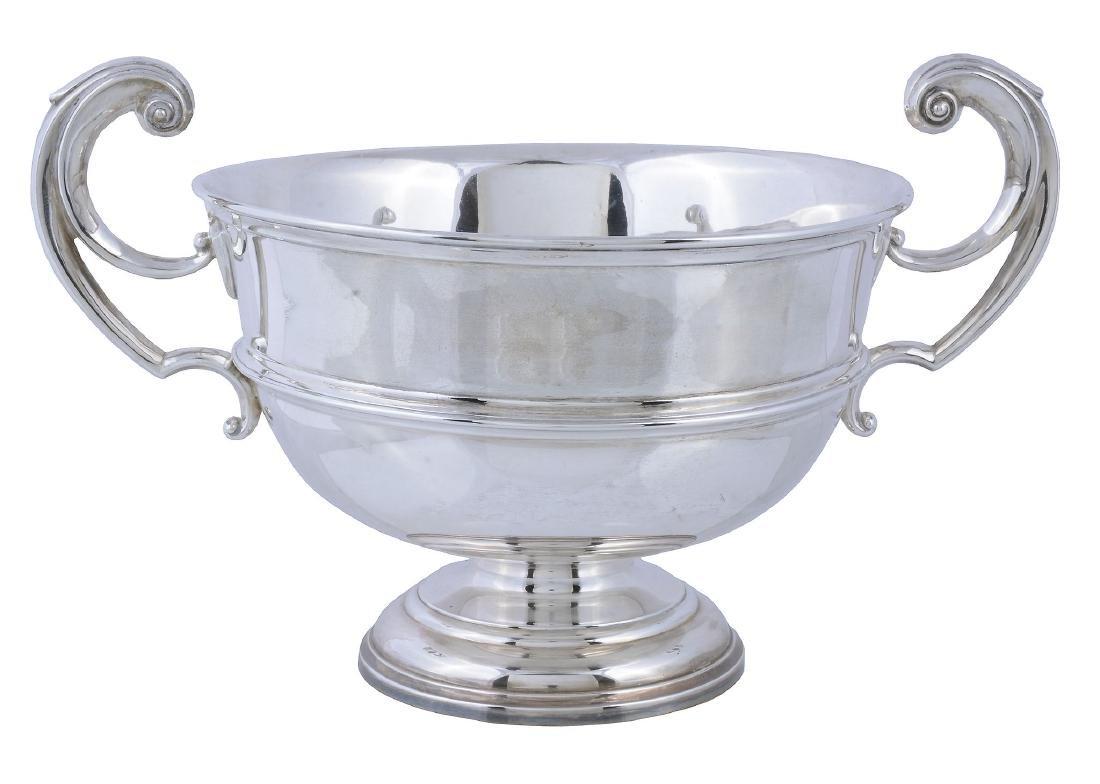 An Edwardian silver twin handled pedestal bowl by James
