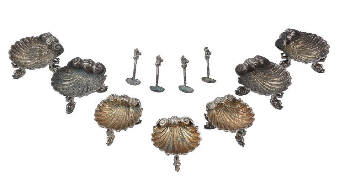 A set of four Victorian silver shell shape salt cellars