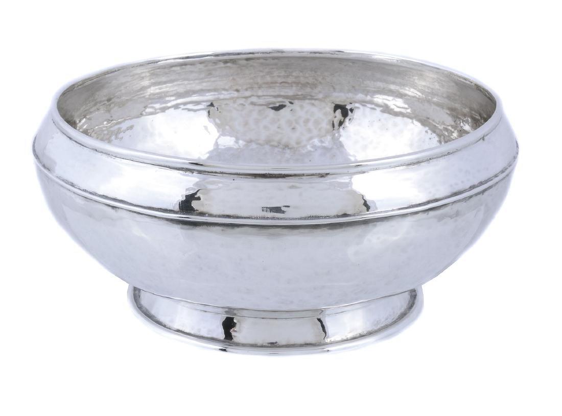 An Arts and Crafts hammered silver circular pedestal