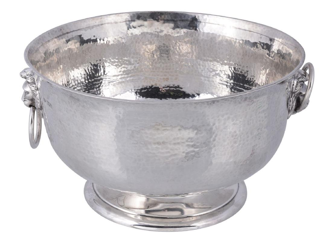 A hammered silver punch bowl by Henry Hodson Plante,