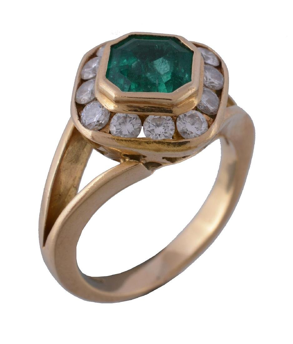 An emerald and diamond cluster ring, the square cut