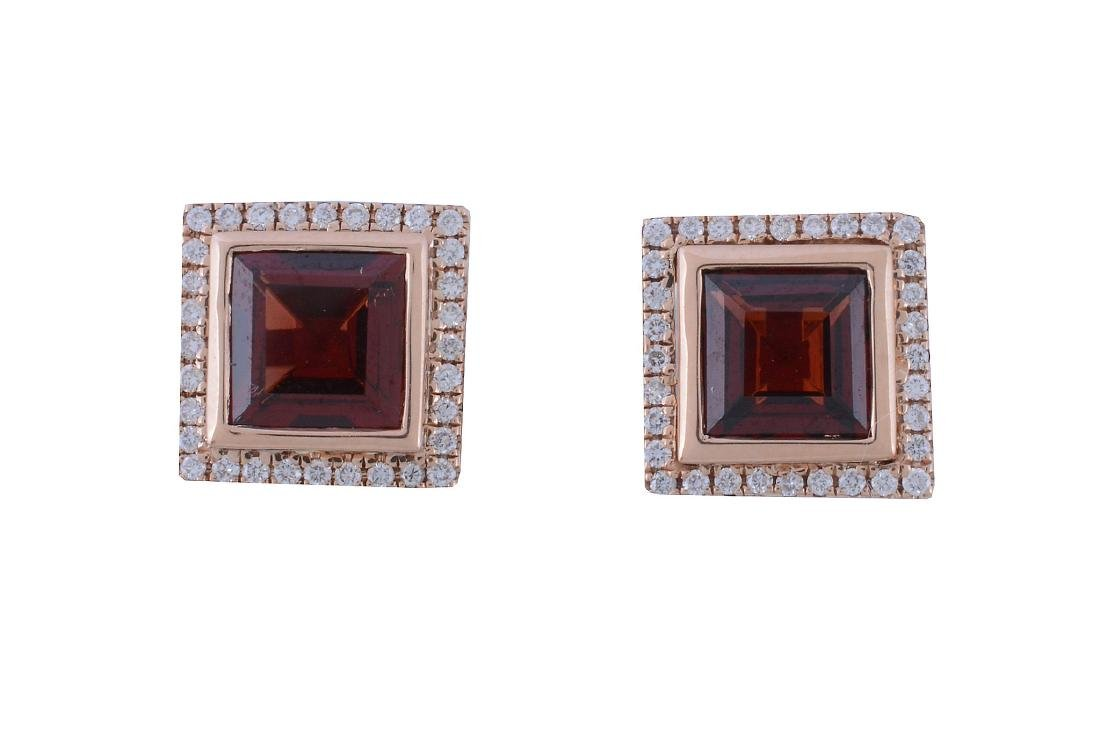A pair of garnet and diamond earrings, the square cut
