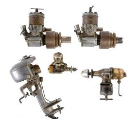 A collection of four model aeroplane engines