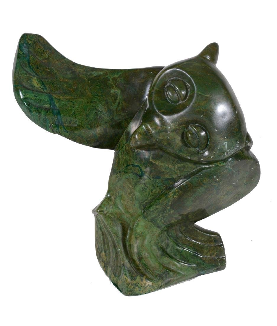 A Zimbabwean hardstone sculpture of an owl, with one