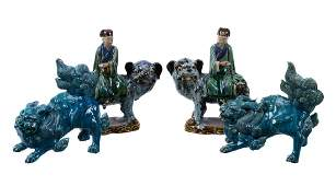 Two Chinese pottery models of guardian lions, covered