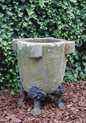 A carved sandstone and cast iron mounted mortar, 19th