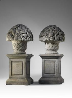 A pair of large Continental carved limestone pier