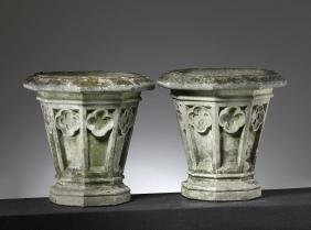 A pair of stone composition garden planters in Gothic