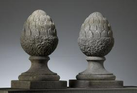 A pair of sculpted limestone pier finials modelled as