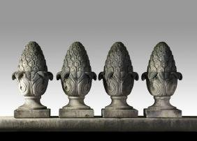 A set of four carved limestone pier finials , 20th