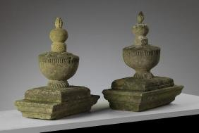 A pair of French carved sandstone pier finials, 19th