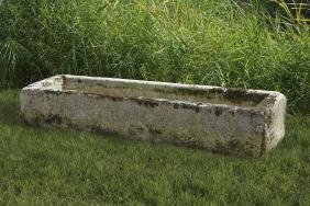 A large Continental carved limestone trough , 18th