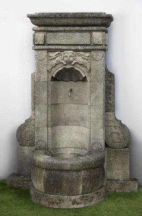 A Continental carved limestone wall fountain , 20th
